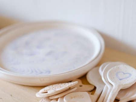 handmade crockery. handicraft pottery. artisan clay plates spoons assortment Stok Fotoğraf