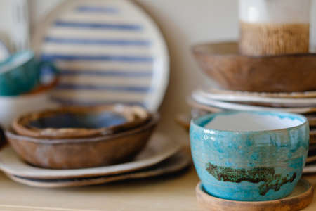 pottery handcraft hobby. assortment of handmade clay plates and jugs