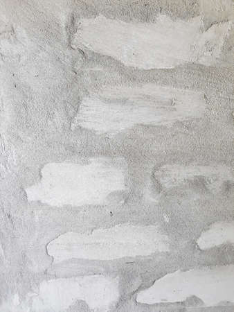 grey cement abstract stucco background. smudged shabby concrete plaster backdrop. copy space concept