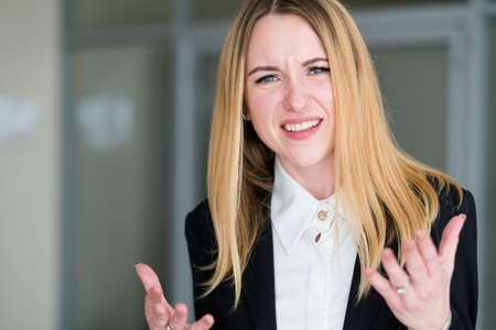 emotion face unbelievable. astonished dumbfounded bewildered astounded shocked perplexed woman. business lady at office workspace. young beautiful blond girl portrait
