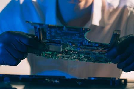 engineering laboratory. technology innovation design and hardware development. technician holding motherboard. Stock Photo