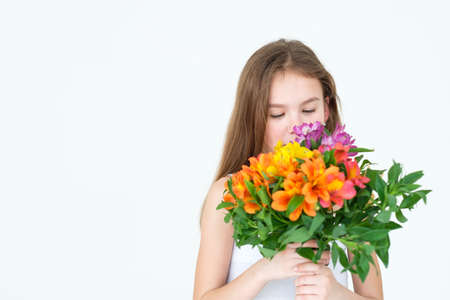 special flower bouquet delivery for someone you love. little girl holding a festive colorful floral arrangement of alstroemeria