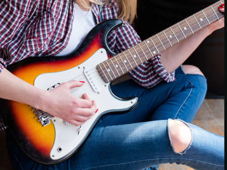 guitar and string musical instrument concept. learn to play and get a new art hobby 版權商用圖片