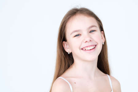 emotion face. joyful beautiful child with a wide smile. little girl portrait on white background. mood feelings personality and facial expression concept