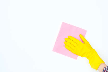 cleaning and sanitation. healthy home atmosphere. hand in yellow protective rubber glove wiping the surface