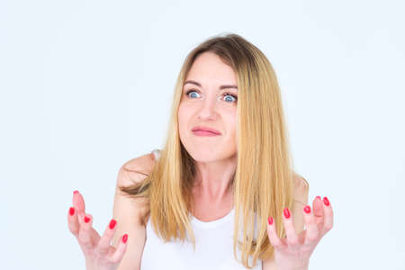 Emotion face. angry mad cross enraged woman. young beautiful blond girl portrait on white background. Stock Photo