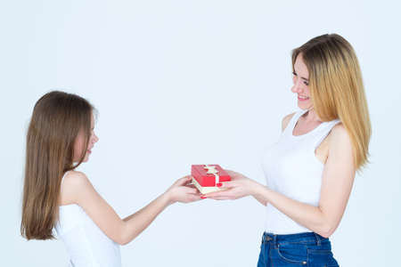 loving and caring family relationship. mother giving present to her child daughter. Stock Photo