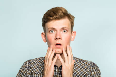 omg unbelievable shock amazement. dumbfounded man with open mouth. portrait of a young guy on light background. emotion facial expression and reaction concept. 写真素材