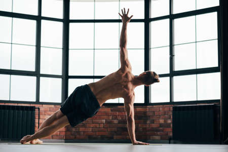 yoga for strong back muscles tonus. healthy spine and vertebras. sporty and fit lifestyle. effective gym exercises for your body. side plank pose vasisthasana.