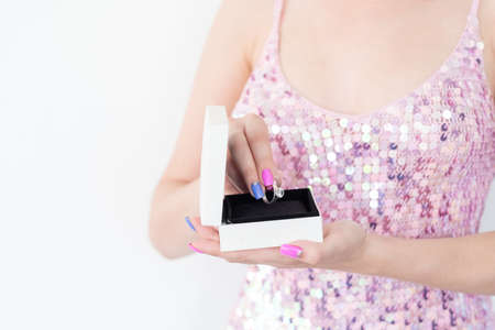 luxury anniversary present. worthy reward for a loved woman. girl holding a diamond ring in a gift box. holiday celebration concept. Stock Photo