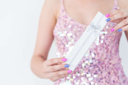 special female jewelry gift. luxury presents and reward concept. woman holding an elegant box with a bow. Stock Photo