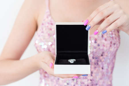 expensive present for someone special. holiday celebration and beautiful jewelry concept. woman holding a diamond ring in a gift box.