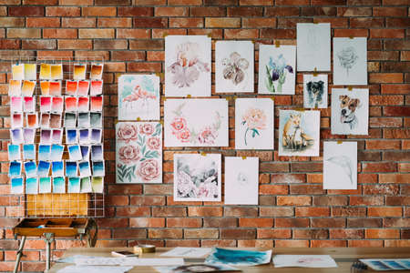 art painting skills. beautiful watercolor drawings collection and color swatch palette on the brick wall. works of a gifted painter.