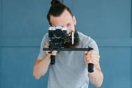 modern technology for video shooting. man holding camera. equipment and tools for blogging and footage content creation.