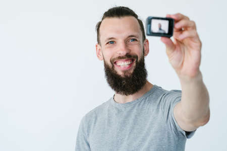 social media influencer creating content. man shooting video of himself using action camera. modern technology concept. Stock Photo