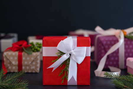 holiday gift for special someone. present in a red box with a white ribbon bow. season greetings and new year celebration concept.