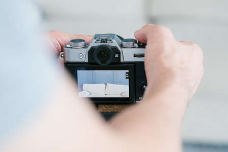 blogger lifestyle and working process.   man setting up camera to start video recording. social network trends and internet business concept. Stock Photo