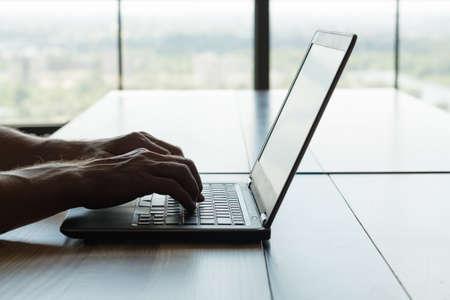 freelance work or remote job. self-employed man working on laptop. hands typing on keyboard. Stockfoto