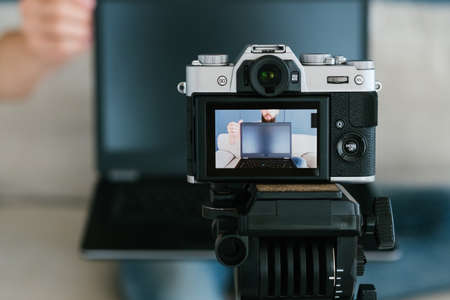 video content creation process. image of a man on a camera screen. shooting footage for blog concept.