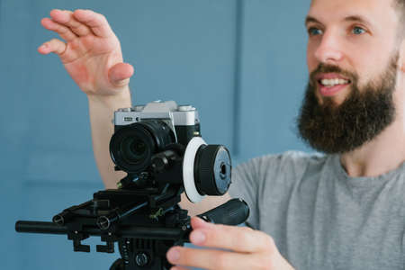 cameraman instructions. creative vision of video making. work in process. man holding camera and directing footage shooting. Stock Photo