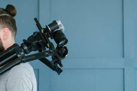 video streaming and blogging concept. helpful equipment for content creation.   cameraman holding camera on shoulder.