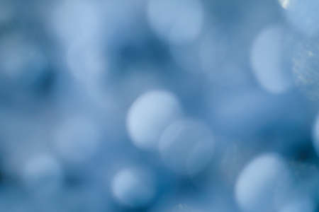 abstract lens flare background. blue defocused bokeh lights. glowing blurred color burst. festive new year backdrop.