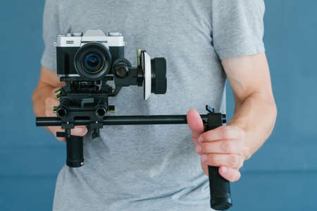 modern technology for video shooting. man using camera holder. equipment and tools for blogging and footage content creation.
