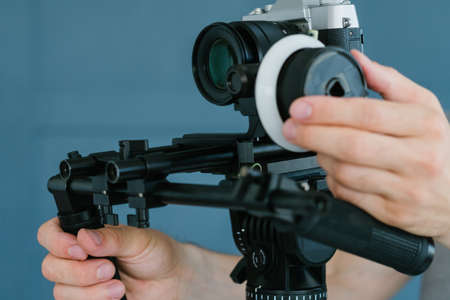 modern equipment for video shooting.   man using camera holder for easy and comfortable footage creation.