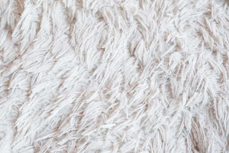 furry white blanket or cloth. textured warm cozy and comfy fabric background. free space concept. Standard-Bild - 108424886