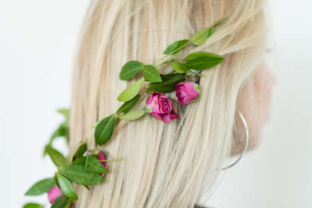 natural hair decor. blond girl wearing fresh flower festive accessories for special occasion.