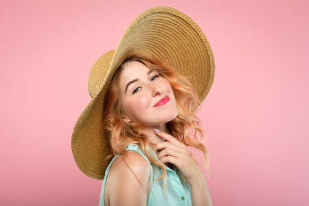 emotion expression very happy joyful thrilled to bits woman with beaming smile and big sunhat. summer vacation vibes. young beautiful blond girl portrait on pink background.