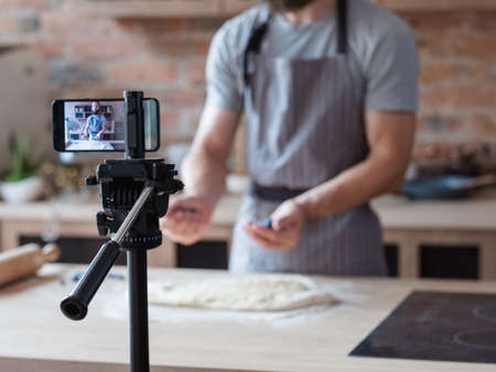 modern technology for photo and video shooting. phone camera on tripod. equipment and tools used by food blogger. 写真素材