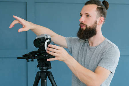 cameraman instructions. video shooting process. man holding camera and pointing with finger directing   on the set. Stock Photo