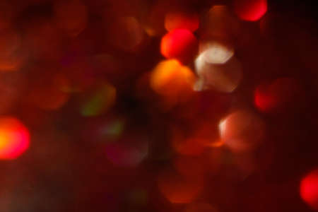 abstract lens flare background. red defocused lights. glowing blurred color burst. festive new year backdrop. Фото со стока