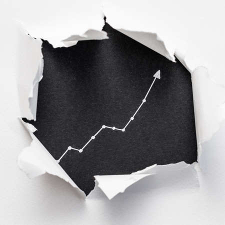 exponential diagram on black background showing through ripped white paper. trend success increase concept. 写真素材