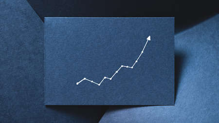 exponential graph on blue layered paper backdrop. growth increase progress concept.