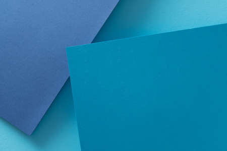 paper layers. abstract dimensional blue background. geometric layout with empty space.