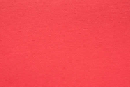 red paper texture background. colored cardboard fibers and grain. empty space concept.