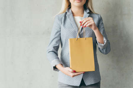 shopping hobby concept. brown paper bag in woman hands.