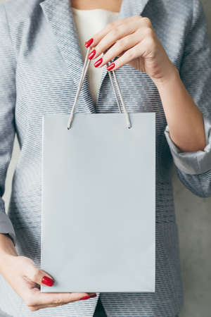 shopping bag in woman hands. addiction to store sales and discounts concept. Stock Photo