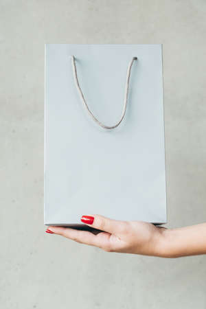 shopping bag on woman hand. consumerism and money spending lifestyle. 스톡 콘텐츠