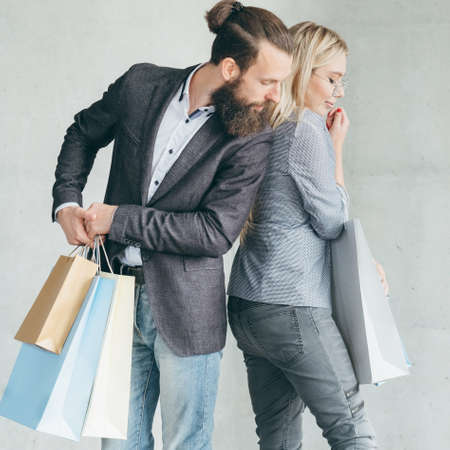 discount hunt and shopping competition. man curious about goods in woman bag.