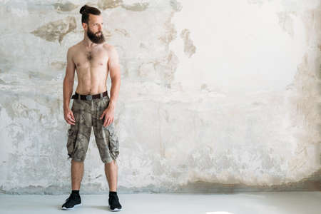 strength power and workout. bare chested fit man standing. healthy sport lifestyle concept. Фото со стока