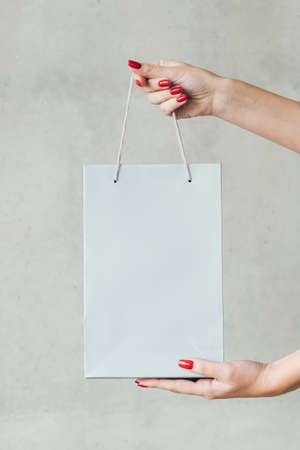 hands holding shopping bag. store sale and discounts. mockup for merchandise. empty space for advertisement. Stock Photo