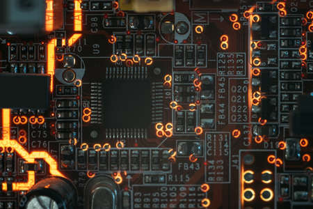 pcb microchip and integrated electronic components. microelectronics and engineering. Stock Photo