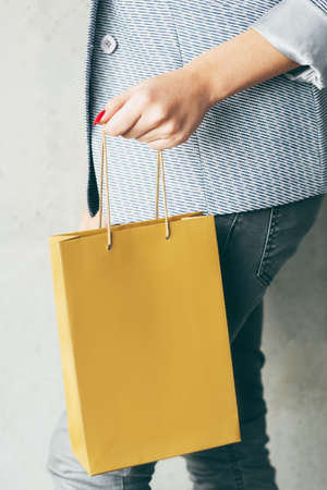 brown paper bag in woman hand. consumerism and shopping concept. Stock Photo