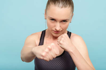woman boxing straight blow. self defence strength training and female fighter concept.