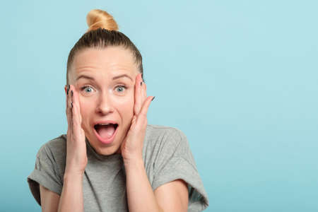 surprised shocked astonished amazed woman with open mouth. unbelievable news. emotional facial expression. Stock Photo