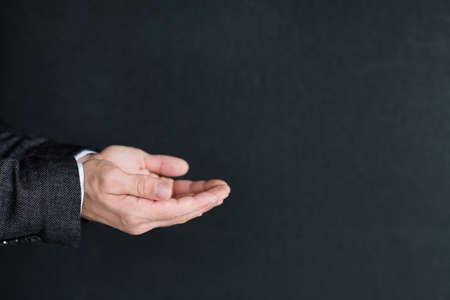 man holding invisible object in palms of hands. empty space for advertising or product placement.