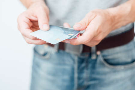 credit card key to banking account. money management and personal finance. man holding plastic cards. Stock Photo
